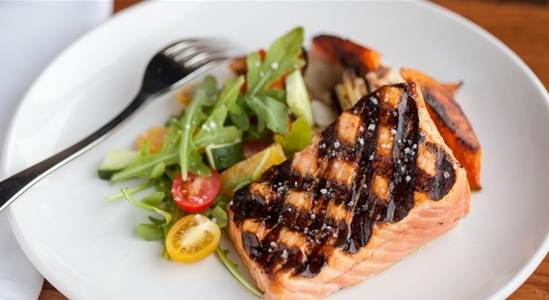 Grilled Salmon on Plate with Vegetables